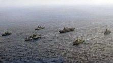 Кораби от четири държави плават заедно във водите на Южнокитайско море. Те участват в Асоциацията на министрите на отбраната на страните от Югоизточна Азия.