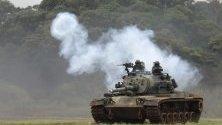 Бойни танкове по време на тренировка за противовъздушна борба в Синчу, Тайван. Учението е част от серията военни учения на  Хан Куанг, които симулират реакцията на въздушните удари на враговете в Тайван.