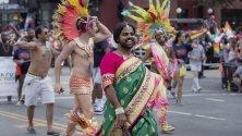 Хора участват в Parade Parade във Вашингтон, САЩ, 08 юни 2019 г. Парадът е част от DC Pride Weekend в празнуване на LGBTQ общността.Хора участват в Parade Parade във Вашингтон, САЩ, 08 юни 2019 г. Парадът е част от DC Pride Weekend в празнуване на LGBTQ общността.