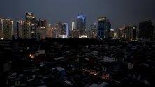 ледка към град Джакарта по време на прекъсване на електрозахранването, Индонезия.