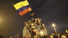 Протестиращи в Кито, Еквадор, празнуват споразумението с правителството, с което се слага край на безредиците.