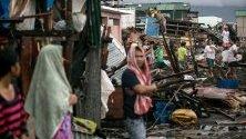 Разрушения след преминаване на тайфуна Камури през Филипините