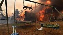 Обхванат от горските пожари дом в Бъкстън, Сидни, Австралия. Страната обяви извънредно положение в щата Нов Южен Уелс на фона на рекордната гореща вълна.